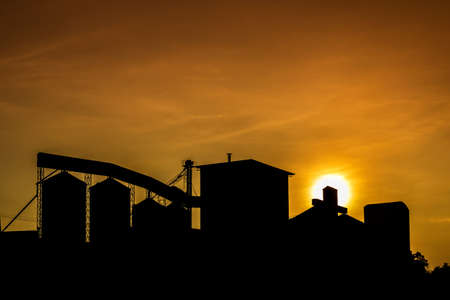 rice mill: Silhouette of rice mill with sunset sky. Stock Photo