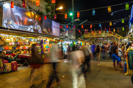 market bottom: CHIANG MAI, THAILAND - JANUARY 30 : Crowded people walking through the market at Anusarn Market on Jan 30, 2015 in Chiangmai, Thailand. Anusarn Market located near the bottom end of the Chiang Mai Night Bazaar.