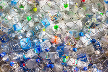 recycling center: CHIANG MAI, THAILAND - NOVEMBER 23 : Recycling center collects plastic bottles on Nov 23, 2014 in Chiang mai, Thailand. In 2013 more than 800,000 tons of recyclables were processed in Thailand; 48.8% more than in 2011.