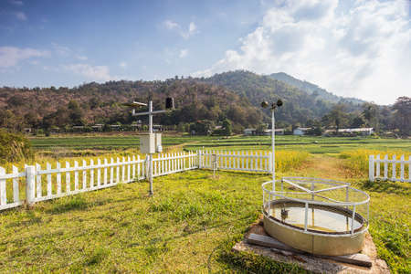 meteorological: Landscape shot Weather Monitoring Stations with rice field background.