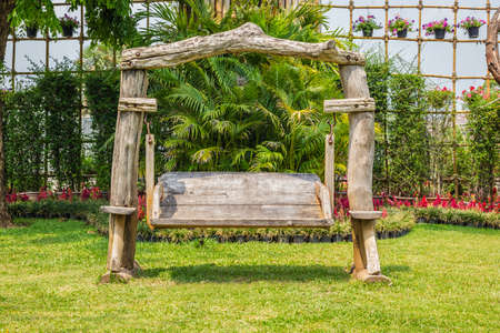 Old Wood Swing Garden Chair On The Grass Stock Photo   39876137