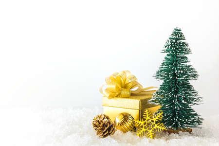 snow ground: Small christmas tree and christmas ornaments on snow ground Stock Photo