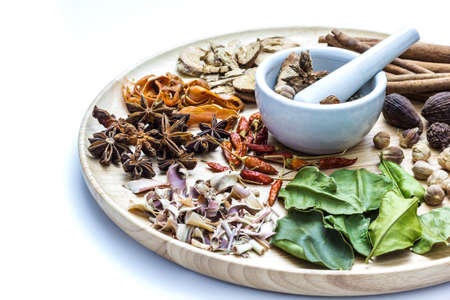 codonopsis roots: A photo of Herbal medicine in wood dish on white isolate background with space for text