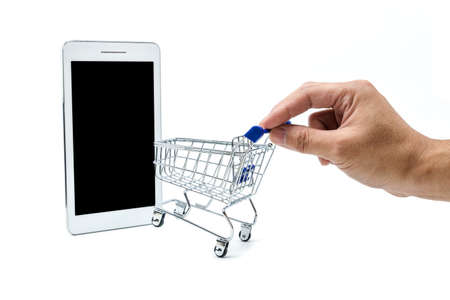 A photo of hand and shopping cart Which headed to the tablet, Thats look like entering the online market. Zdjęcie Seryjne