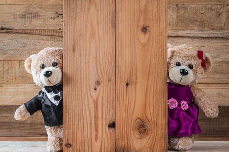 A photo of Cute teddy bears on old wood background with copy space Zdjęcie Seryjne