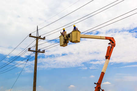 A phooto of Electricity Authority on cable car to maintenance a electric cable