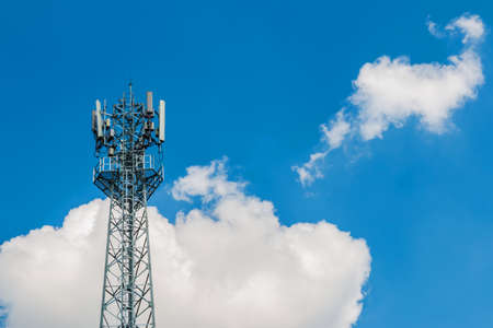 A photo of Phone tower antenna with blue sky and cloud background
