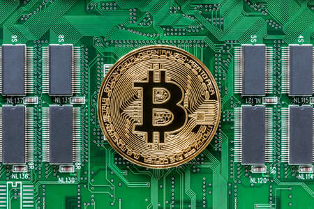 A photo of gold Bit coin on Printed Circuit Board, Bit coin and blockchain concept