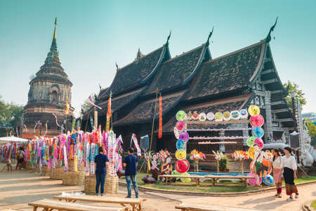 CHIANGMAI, THAILAND-APRIL 14 : Songkran Festival is celebrated in a traditional New Years Day, Unidentified people are comes to decorat tung in Wat Lok Moli temple. on April 14, 2018 in Chiang Mai,Thailand. Publikacyjne