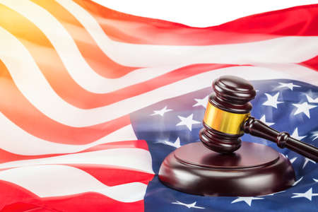 A photo of gavel and USA flag. Law concept photo