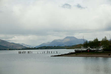loch lomond: Loch Lomond, Scoland with cloudy skies, the hills in the distance are sunlit