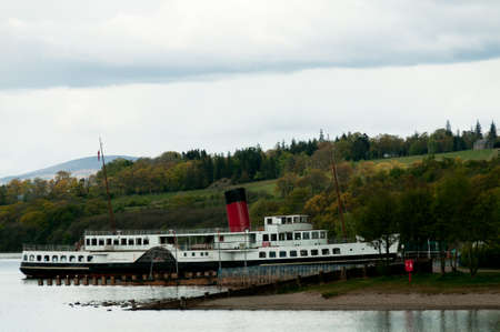 loch lomond: The Maid of the Loch is a historic steamship moored at Loch Lomond Scotland Stock Photo