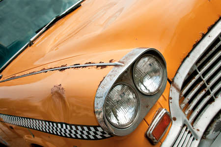rusting: old yellow rusting taxi