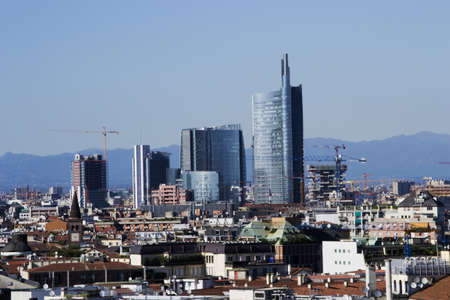 Landscape panoramic of Milano - the new distcrit of garibaldiPorta Nuova  - The Alps on background photo