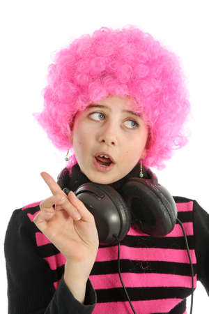 Young girl with headphones and pink hair to listen music, isolated on white background