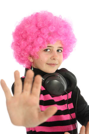 Young girl with headphones and pink hair to listen music, show his hand and say STOP
