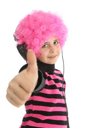 Young girl with headphones and pink hair to listen music say OK, isolated on white background Banque d'images