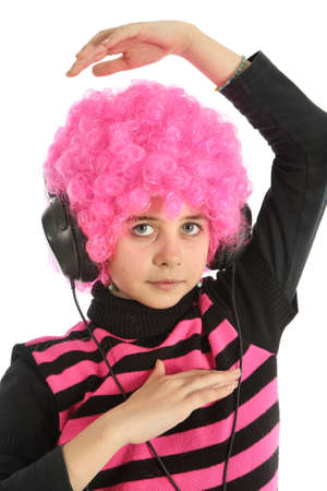 Young girl dancing with headphones and mp3 player