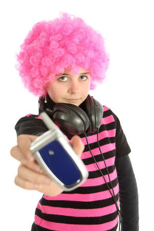Young girl with pink hair shows a vintage telephone, isolated on white background