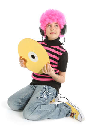 Child with pink hair and large CD disk listening music, isolated on white background