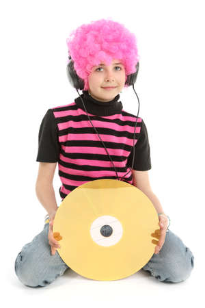 Young girl with large CD and pink hair, listening music, isolated on white background