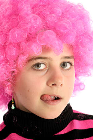 Portrait of girl with pink hair sticking out her tongue, isolated on white backround
