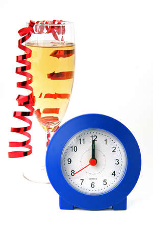 New Year celebration concept. A glass of champagne with a clock and a festive ribbon cut out on a white background