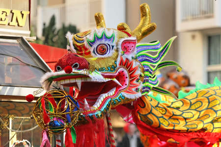 Multicolored Chinese New Year dragon in Paris. Chinese New Year is called the festival or spring festival in China. 2021 will celebrate the year of the buffalo, the tiger in 2022 Banque d'images