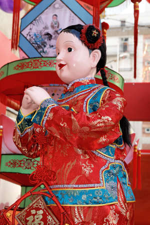 Chinese New Year doll in disguise in Paris 2008. Chinese New Year is called the festival or spring festival in China. 2021 will celebrate the year of the buffalo, the tiger in 2022 版權商用圖片