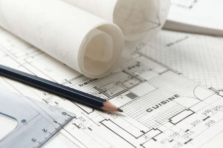 Home and kitchen renovation plans with rolls of drawings, pencil and square ruler. Architecture and building construction concept Banque d'images