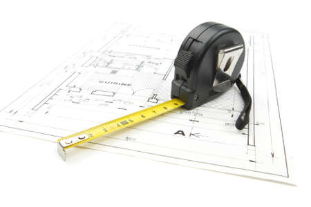 Architecture concept with black tape measure on a construction plan isolated on white background in studio Banque d'images