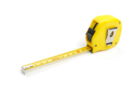 Partially unwound yellow tape measure, cut out and isolated on white background Banque d'images