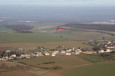 Aerial view of a paramotor flying over the commune of Soindres in the Yvelines department (78200), Ile-de-France region, France - January 03, 2010 Banque d'images