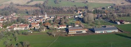Panorama of Chaussy en Vexin seen from the sky, a small rural village with its agricultural farm, in Val-d'Oise department (95710); Ile-de-France region, France - January 03, 2010