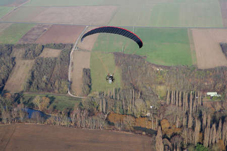 Aerial close-up paramotor photograph flying over an arm of the Seine river at Mantes-la-Jolie, in the Yvelines department (78200), Ile-de-France region, France - January 03, 2010