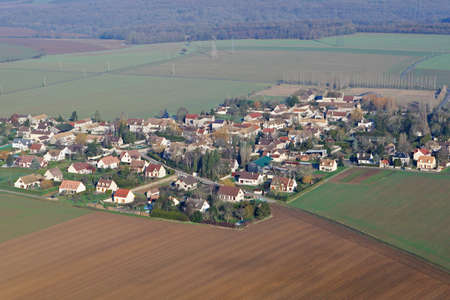 Aerial view of Boinvilliers village in the middle of the fields in the Yvelines department (78200), Ile-de-France region, France - January 03, 2010