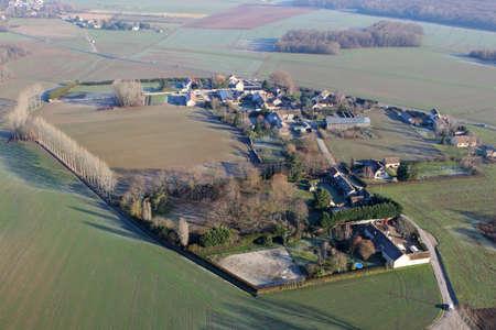 Aerial photography of the rural Favière village in the department of Eure-et-Loir (28), Center-Val de Loire region, France - January 03, 2010