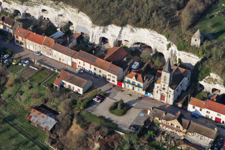 Aerial view of Mousseaux-sur-Seine village, the church and white cliffs troglodythes in the Yvelines department (78270), Ile-de-France region, France - January 03, 2010