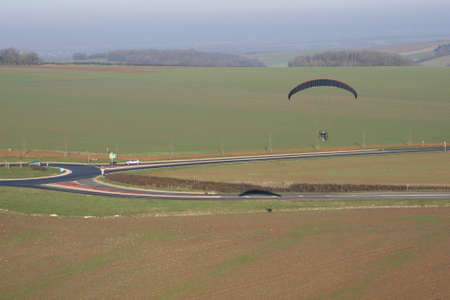 Aerial photograph of a paramotor (motorized paraglider) flying over a roundabout in soindres fields, Yvelines department (78200), Ile-de-France region, France - January 03, 2010 Banque d'images
