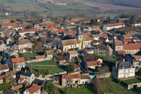 Ormeville, France - January 03, 2010: Aerial photography of Omerville, a small rural village of Vexin grouped around its church, in Val-d'Oise department (95420), Ile-de-France region.