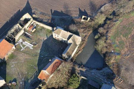 Favière, France - January 03, 2010: Aerial photograph of a farm in Favière village in the department of Eure-et-Loir (28), Center-Val de Loire region.