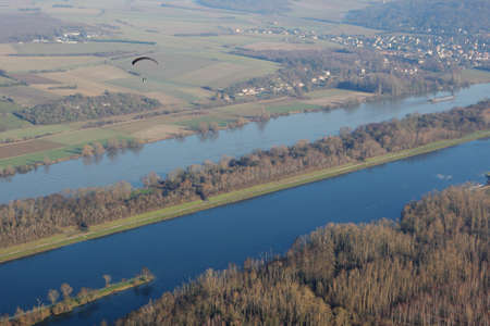 Aerial photography paramotor flying over the Seine river at Mantes-la-Jolie, in the Yvelines department (78200), Ile-de-France region, France - January 03, 2010