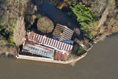 Mantes-la-Jolie, France - January 03, 2010: Aerial view of a house on the banks of the Seine river, in Yvelines department (78200), Ile-de-France region