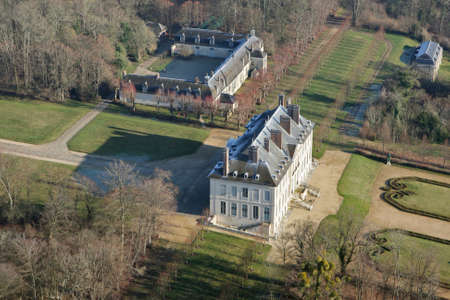 Chaussy, France - January 3, 2010: Aerial view of Villarceaux castle and estate in the department of Val-d'Oise (95710); Ile-de-France region, France