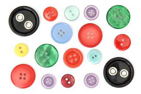 Set of different and colored sewing buttons, cut out and isolated on white background Banque d'images