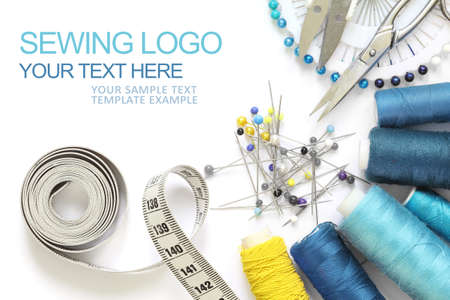 Sewing accessories template, business card type with sample logo, scissors, measuring tape, spool of thread and needle isolated and cut-out on white background. blue and yellow design Banque d'images
