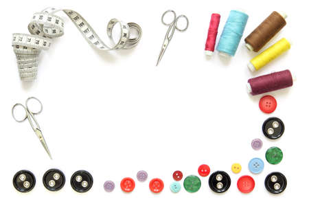 composition with colorful sewing tools and accessories cut-out and isolated in white frame with scissors, buttons and tape measure