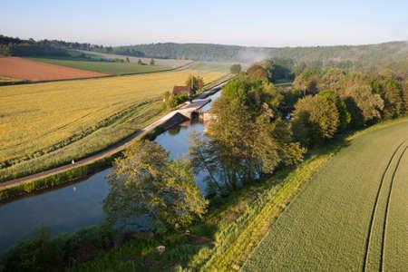 Lock of Ravereau seen from the sky in Merry-sur-Yonne, Nivernais canal, in Yonne department, Bourgogne-Franche-Comté region, France.