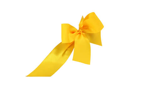 Decorative yellow ribbon and bow cut out and isolated on white background Banque d'images