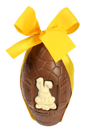 Easter celebration concept: big chocolate egg with yellow ribbon and Easter bunny, isolated on white background without shadows Banque d'images